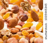 falling nuts closeup in the... | Shutterstock . vector #1035445345