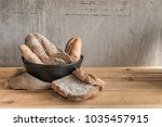 male baker prepares bread. male ... | Shutterstock . vector #1035457915
