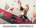 woman practicing rock climbing... | Shutterstock . vector #1035458215