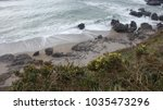 the incoming tide forms a... | Shutterstock . vector #1035473296