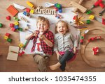 kids drawing on floor on paper. ... | Shutterstock . vector #1035474355