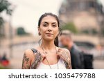 smiling young tourist woman... | Shutterstock . vector #1035479788