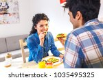 young couple sitting by table... | Shutterstock . vector #1035495325