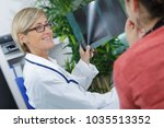 young female doctor looking at... | Shutterstock . vector #1035513352