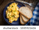 scrambled eggs with onion and...   Shutterstock . vector #1035521626