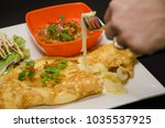 omelette cheese stretched out... | Shutterstock . vector #1035537925