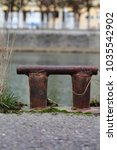 Small photo of Antic rusty boat lining holder.