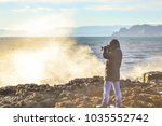 a man with a camera looks at... | Shutterstock . vector #1035552742