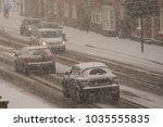 traffic chaos in blizzard... | Shutterstock . vector #1035555835