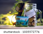 saving money in a jar for a... | Shutterstock . vector #1035572776