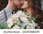 stylish bride and groom on the... | Shutterstock . vector #1035588655