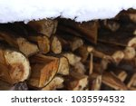 Woodpile Covered With Snow In...