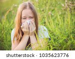 Young Woman Sneezes Because Of...