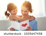 happy mother's day  child... | Shutterstock . vector #1035647458