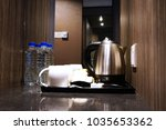 Stock photo coffee making set in a hotel room with stainless steel electric kettle clean cup teaspoon and 1035653362
