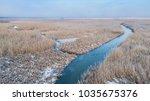 lake in winter. location ... | Shutterstock . vector #1035675376