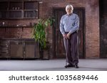 portrait of senior man with... | Shutterstock . vector #1035689446