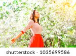 happy woman enjoying smell... | Shutterstock . vector #1035699586