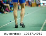 Small photo of Sportsman getting ready in long jump competition. Track and field competitions concept background