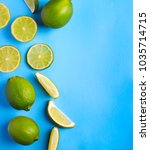 fresh limes on light blue... | Shutterstock . vector #1035714715