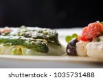 delicious roasted asparagus... | Shutterstock . vector #1035731488