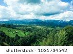green hills on a summer day | Shutterstock . vector #1035734542