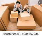 happy young couple moving to... | Shutterstock . vector #1035757036