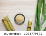 sugar cane and brown sugar on... | Shutterstock . vector #1035779572