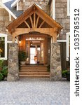 stone and wood front porch... | Shutterstock . vector #1035785512
