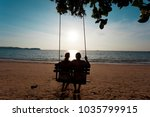 Couple In Love On A Swing Under ...