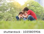 happy young asian family with... | Shutterstock . vector #1035805906