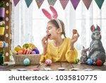 beautiful child is eating... | Shutterstock . vector #1035810775