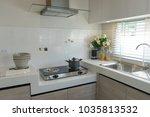 modern kitchen with wood... | Shutterstock . vector #1035813532