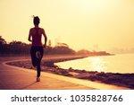 sporty fitness woman running on ...   Shutterstock . vector #1035828766