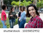 laughing mexican young adult... | Shutterstock . vector #1035852952