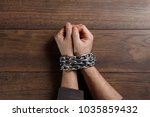 close up  men's hands are chain ... | Shutterstock . vector #1035859432