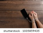 close up  hands of a man tied... | Shutterstock . vector #1035859435