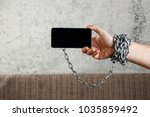 close up  the man's hand is... | Shutterstock . vector #1035859492