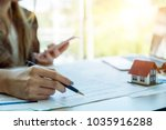 real estate agent with house... | Shutterstock . vector #1035916288