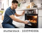 man taking baking tray with... | Shutterstock . vector #1035940306