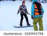 instructor giving snowboard... | Shutterstock . vector #1035941758