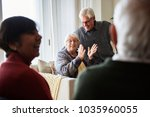 senior people talking in a... | Shutterstock . vector #1035960055