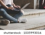 young woman using laptop... | Shutterstock . vector #1035993016