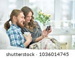 young couple taking selfie | Shutterstock . vector #1036014745