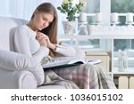 young attractive woman reading... | Shutterstock . vector #1036015102
