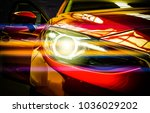 Stock photo car headlights exterior detail car luxury concept 1036029202