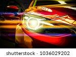 car headlights. exterior detail.... | Shutterstock . vector #1036029202