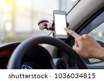 hand of driver using smartphone ... | Shutterstock . vector #1036034815