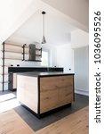new kitchen in oak and black... | Shutterstock . vector #1036095526