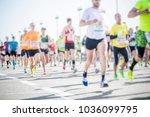 marathon runners in the city | Shutterstock . vector #1036099795